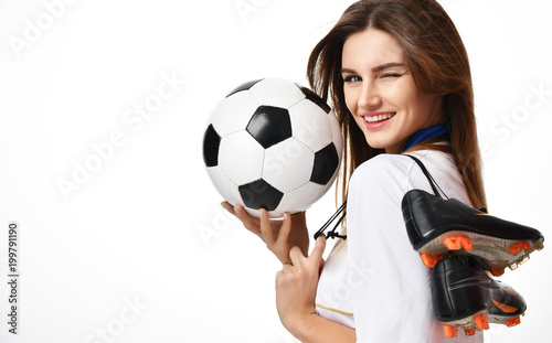 Plexiglas Voetbal Fan sport woman player in red uniform hold soccer ball and boots celebrating winking on white