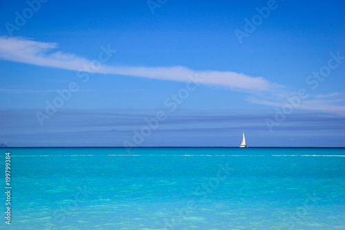 Keuken foto achterwand Tropical strand White sailboat against blue sky and sea, Antigua, Antigua and Baruda.