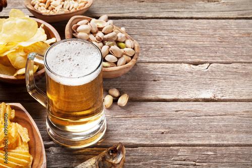 Lager beer mug and snacks