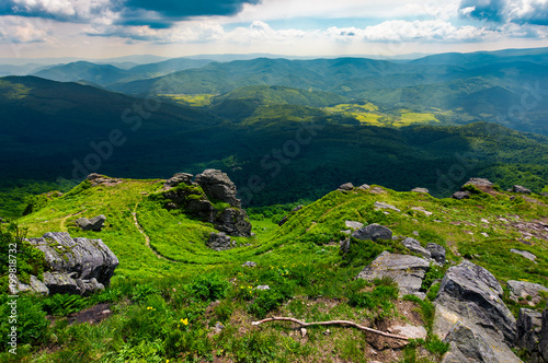 Plexiglas Tijger path to a tiger face cliff above the valley. spectacular landscape of Carpathian mountains in summertime. location Pikui mountain, Ukraine
