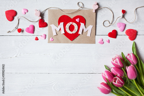 Background for congratulations for Mother's Day with greeting card, hearts and pink tulips - 199824162