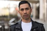 Hispanic man in city serious face - 199825545
