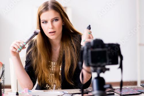 Foto Murales Beauty blogger filing video for her blog or vlog