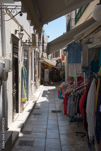 Fotobehang Smalle straatjes Ermoupoli, Syros - Greece. The old town of Ermoupoli on Syros island with many small shops