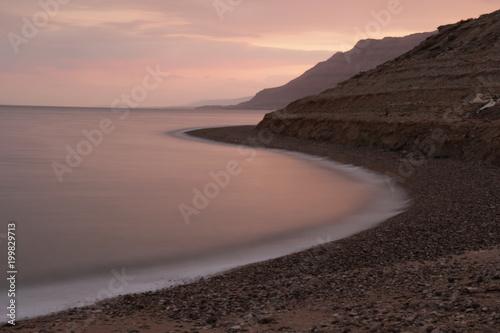Fotobehang Zee zonsondergang Pink Water