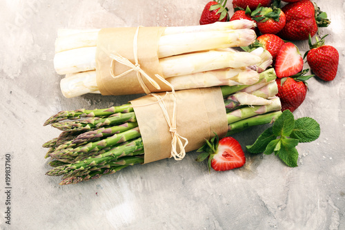 White and green asparagus with strawberries
