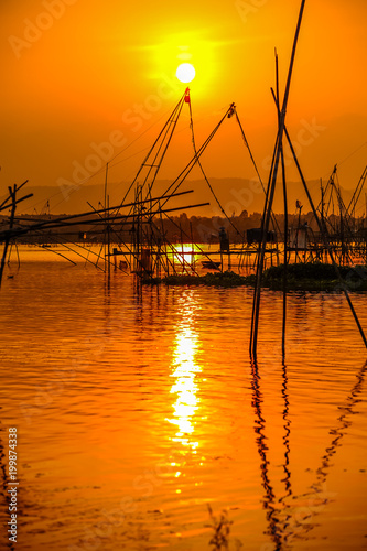 Poster Oranje eclat Traditional bamboo and wooden fishing tools in swamp