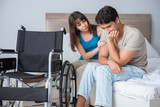Desperate man on wheelchair with his sad wife - 199876785