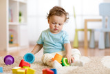 baby kid toddler playing toys at home or nursery - 199883350