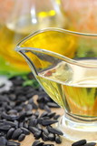 Sunflower oil in glass and sunflower seeds