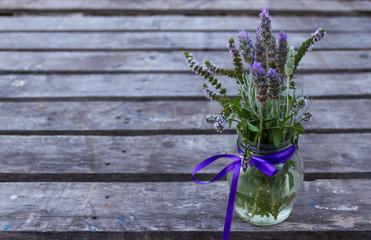 decorative border of lavender on rustic wood