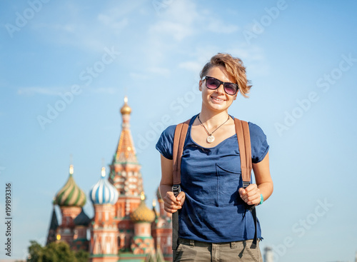 Fotobehang Moskou Beautiful young female student walks on Red Square in Moscow, travels to Russia