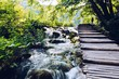 Wooden path over beautiful river cascades - 199893541