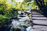 Wooden path over beautiful river cascades
