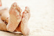 women's feet in the sand, beach rest and relax concept