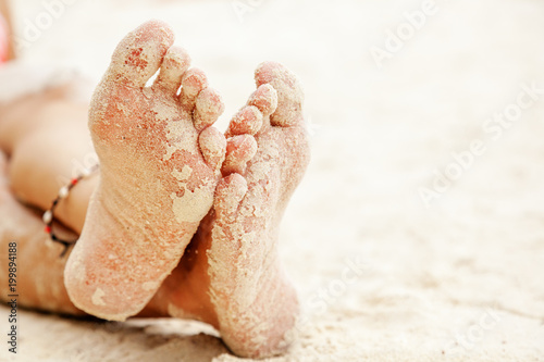 women's feet in the sand, beach rest and relax concept - 199894188
