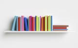 Multicolored books on a shelf - 199899729
