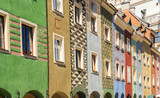 facades of colorful crooked medieval houses on the central market square in Poznan, Poland
