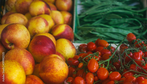 tasty sweet fresh good looking fruits and vegetables on farmers market