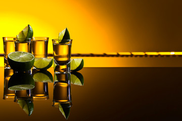 Mexican Gold Tequila in short glasses with lime