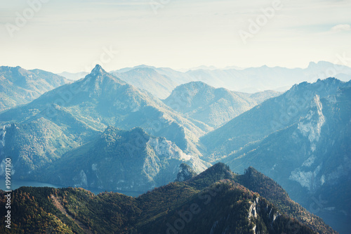 Foto op Canvas Herfst Mountain peaks in foggy morning. Austrian Alps