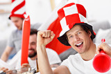 Happy male friends cheering and watching sports on tv - 199926970