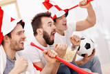 Happy male friends cheering and watching sports on tv - 199928331