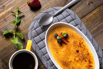 Creme Brulee Dessert with Caramelised Sugar, Strawberry, Blueberry and Fresh Mint Leaves