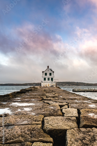 Foto Murales Colorful Clouds Above The Rockland Harbor Breakwater Light