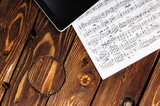 Tablet PC and sheet music on the table. Composing music. - 199950580