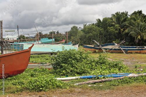 Foto op Plexiglas Schip Stranded balangay or bangka boats-Poblacion barangay beach. Sipalay-Philippines. 0389