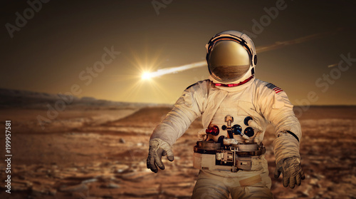 Fotobehang Nasa Astronaut exploring the surface of red planet Mars. Space Mission. Elements of this image furnished by NASA.