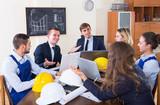 professionals  having meeting indoors - 199958345