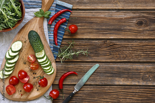 Plexiglas Hot chili peppers Close-up photo of fresh vegetables on wooden cutting board with knife on vintage wooden background