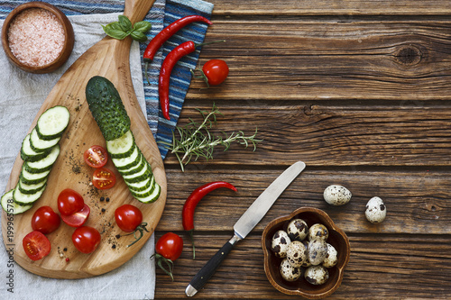 Foto op Plexiglas Hot chili peppers Close-up photo of fresh vegetables on wooden cutting board with knife on vintage wooden background
