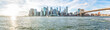 Panoramic Panorama view, overlook of outside outdoors in NYC New York City Brooklyn Bridge Park by east river, cityscape skyline during sunset with sun