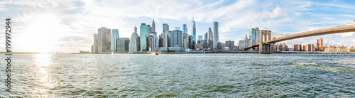 Panoramic Panorama view, overlook of outside outdoors in NYC New York City Brooklyn Bridge Park by east river, cityscape skyline during sunset with sun © ablokhin