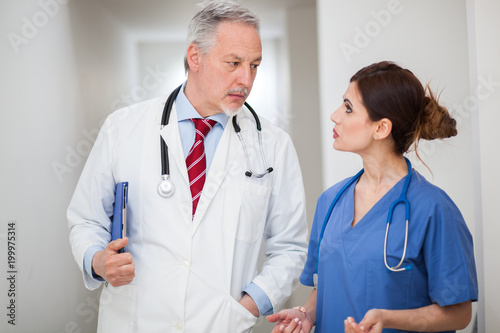 Two doctors discussing - 199975314