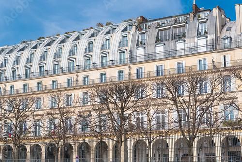 Wall mural Paris, beautiful building in the center, typical parisian facade, rue de Rivoli