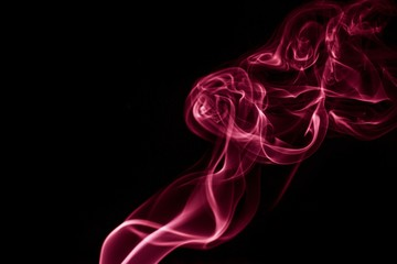 Colored smoke on black background.