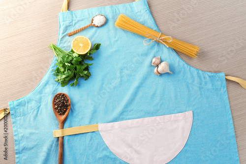 Fotobehang Kruiden 2 Apron and products for cooking master class on wooden background