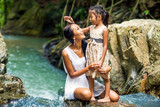 asian happy mother with her daughter in the tropics near the waterfall. Mothers day.
