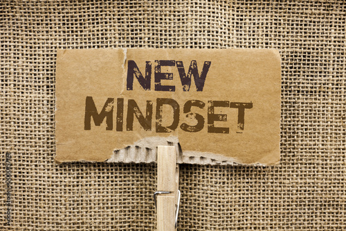 Writing note showing  New Mindset. Business photo showcasing Attitude Latest Concept Vision Behaviour Plan Thinking written on Cardboard Piece Holding By Clip on the jute background.