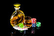Decanter with glass of whiskey and poker cards with chips