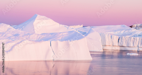 Aluminium Lichtroze Iceberg from glacier in arctic nature landscape on Greenland - aerial photo
