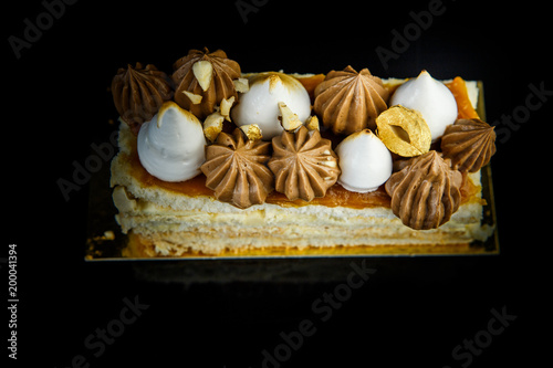 Foto op Plexiglas Kiev top view on piece of double layer Kiev cake with cream and nuts