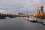 Cityscape of central London with river Thames in foreground and north and south Embankments along with St Pauls cathedral and the city and famous skyscrapers