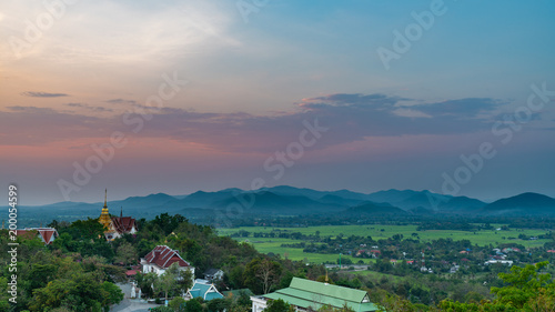 Foto Murales Wat Phrathat Doi Saket with colorful sunset sky and clouds. Chiang Mai, Thailand.