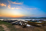 Sunset over the fishing boats anchoring on lake in Lak, Dak Lak province, Vietnam.