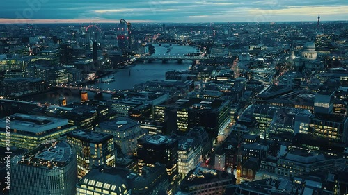 Aerial of St Paul's cathedral and surrounding cityscape. High view over London city with the River Thames and to the right is St Paul's Cathedral